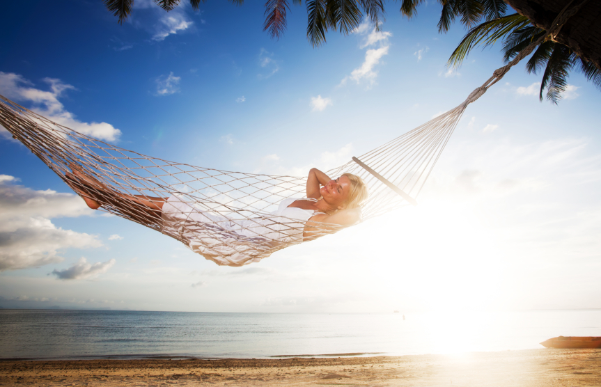 Young woman resting on the tropical beach, lying in a hammock and enjoying. [url=http://www.istockphoto.com/search/lightbox/9786750][img]http://img291.imageshack.us/img291/2613/summerc.jpg[/img][/url]